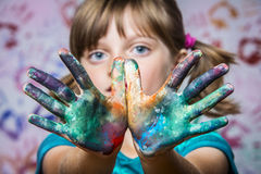 Happy little girl playing with colors stock photography