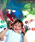 Happy little girl playing with colors Royalty Free Stock Images