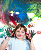 Happy little girl playing with colors Stock Images