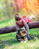 Little girl playing with the dog royalty free stock photos