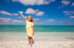 Happy little girl playing with flying kite during Royalty Free Stock Photo