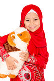Happy little girl playing with her sheep toy - celebrating Eid u Royalty Free Stock Photography