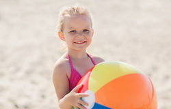 Happy little girl playing inflatable ball on beach Royalty Free Stock Photography
