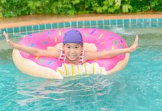 Happy little girl playing with inflatable ring royalty free stock photo