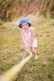 Happy little girl playing Stock Photo