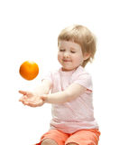 Happy little girl playing with orange Royalty Free Stock Photo