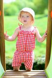 Happy little girl playing outdoors Stock Photo