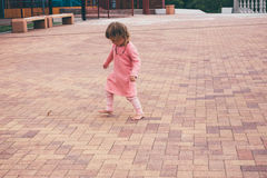 Happy little girl playing outdoors. Happy little girl playing outdoors in the day Stock Images