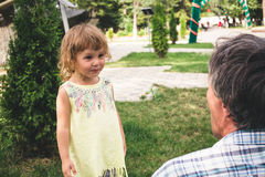 Happy little girl playing outdoors. Happy little girl playing outdoors in the day Royalty Free Stock Photography