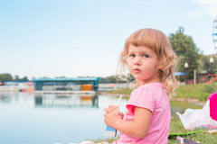 Happy little girl playing outdoors. Stock Images