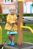 Happy little girl playing outdoors Stock Photography