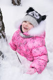 Happy little girl  playing outdoors  in winter park Royalty Free Stock Photos