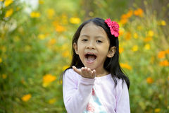 Happy little girl playing outside Royalty Free Stock Photo