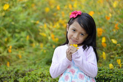 Happy little girl playing outside Royalty Free Stock Photography