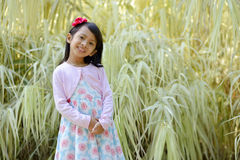 Happy little girl playing outside Royalty Free Stock Images