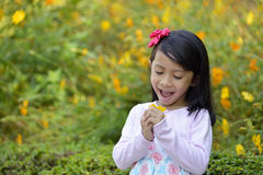 Happy little girl playing outside Royalty Free Stock Image