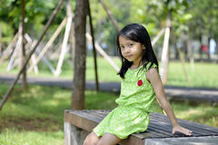 Happy little girl playing outside Stock Images