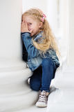 Happy little girl playing peekaboo Stock Photo