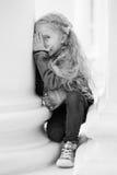 Happy little girl playing peekaboo Royalty Free Stock Image