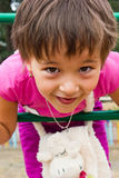 Happy, little girl playing on the playground Royalty Free Stock Photo