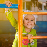 Happy little girl playing on a playground Royalty Free Stock Photos