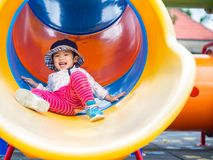 Happy little girl playing at the playground. Children, Happy, Fa stock image