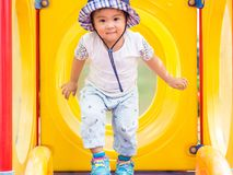 Happy little girl playing at the playground. Children, Happy, Fa stock photography