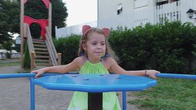 Adorable happy little girl has fun outdoors. stock video footage