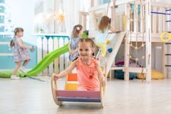 Happy little girl playing in playroom royalty free stock images