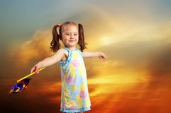 Happy little girl playing with a propeller Stock Photo