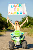 Happy little girl playing on road at the day time. He driving on Royalty Free Stock Image