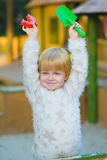Happy little girl playing in sandbox at playground Royalty Free Stock Photos