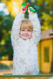 Happy little girl playing in sandbox at playground Royalty Free Stock Photo