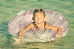 Happy little girl playing on the sea Royalty Free Stock Images