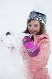 A happy little girl playing with snow Royalty Free Stock Photos