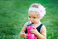 Happy Little girl playing in summer meadow on grass Royalty Free Stock Photos