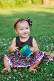 Happy Little girl playing in summer meadow on grass Stock Photo