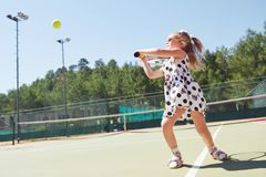 Happy little girl playing tennis Stock Photo