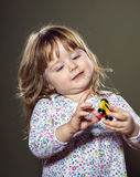 Happy little girl playing with toys Royalty Free Stock Photos