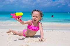 Happy little girl playing with toys at beach Royalty Free Stock Photos