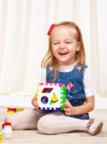 Happy little girl playing with toys Royalty Free Stock Photo