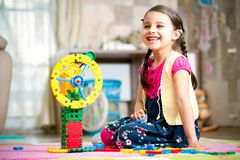 Happy Little Girl Playing With Toys At Home. Happy Little Girl Is Playing With Toys At Home stock image