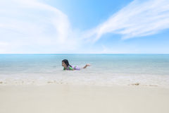 Happy little girl playing on the tropical beach Royalty Free Stock Photography