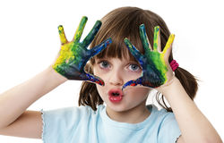 Play with colors. Happy little girl playing with water colors royalty free stock image