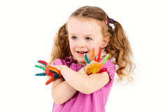 Happy little girl playing with watercolors Stock Photo
