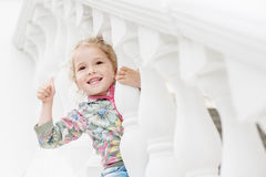 Happy little girl playing Royalty Free Stock Images