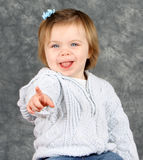 Happy little girl pointing royalty free stock photos