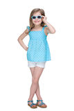 Happy little girl in a polka dot blue dress Royalty Free Stock Photography