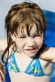 Happy little girl in pool Royalty Free Stock Images