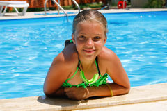 Happy little girl in the pool. Stock Photo
